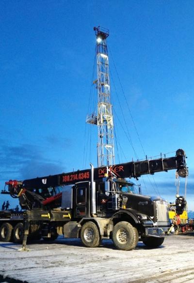 Dekker Oilfield Services picker truck on oil well